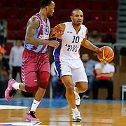 Anadolu Efes's Dontaye Draper (R) and Trabzonspor's Demarquis D'Angelo Bost (L) during their Turkish Basketball League Play Off Semi Final round 1 match Anadolu Efes between Trabzonspor at Abdi Ipekci Arena in Istanbul Turkey on Friday 29 May 2015. Photo by Aykut AKICI/TURKPIX