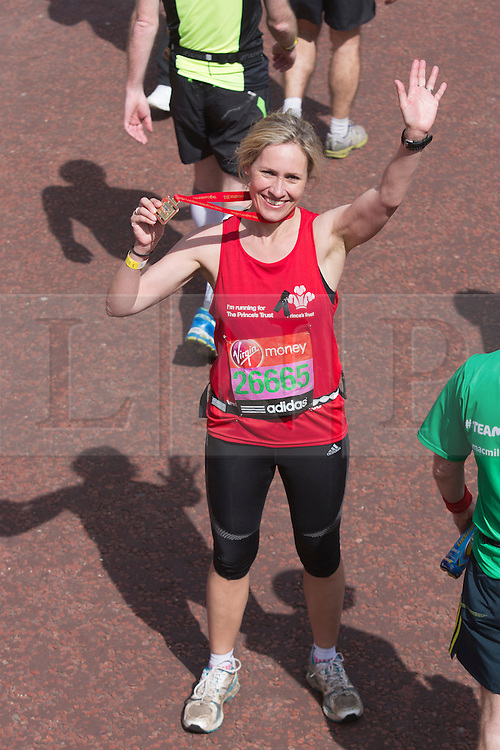 © Licensed to London News Pictures. 21/04/2013. London, England. Picture: Sophie Raworth. Celebrity Runners and Fun Runners finish the Virgin London Marathon 2013 race in the Mall, London. Many wore black ribbons to pay their respect for those who died or were injured in the Boston Marathon. Photo credit: Bettina Strenske/LNP