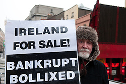 © under license to London News Pictures.  07/12/2010. Eamon Reid from Dublin protests against the planned Irish budget in front of Leinster House, Dublin, Ireland on 7/12/2010. Photo credit should read Michael Graae/London News Pictures