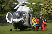 MD902 Explorer helicopter crew from the Kent, Surrey & Sussex Air Ambulance Trust on the ground in Ruskin Park after emergency flight to Kings College Hospital in south London.