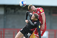 Josh Doherty of Crawley Town and Jordan Hallam (18) of Scunthorpe United battles for possession with during the EFL Sky Bet League 2 match between Crawley Town and Scunthorpe United at The People's Pension Stadium, Crawley, England on 19 September 2020.