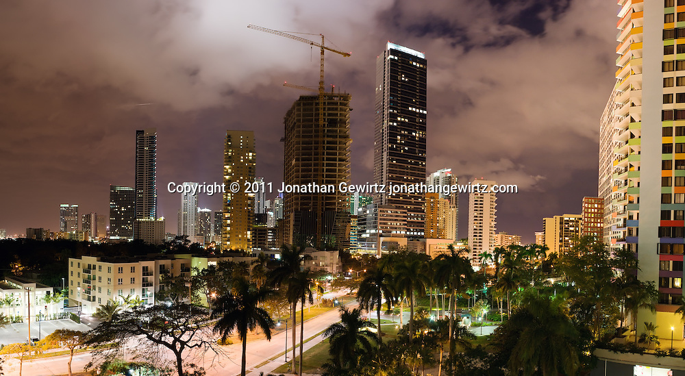 A panoramic view of Miami's Brickell Avenue and the Brickell neighborhood at night, showing residential and commercial buildings, including the last local buildings under construction as the real estate boom came to an end. WATERMARKS WILL NOT APPEAR ON PRINTS OR LICENSED IMAGES.