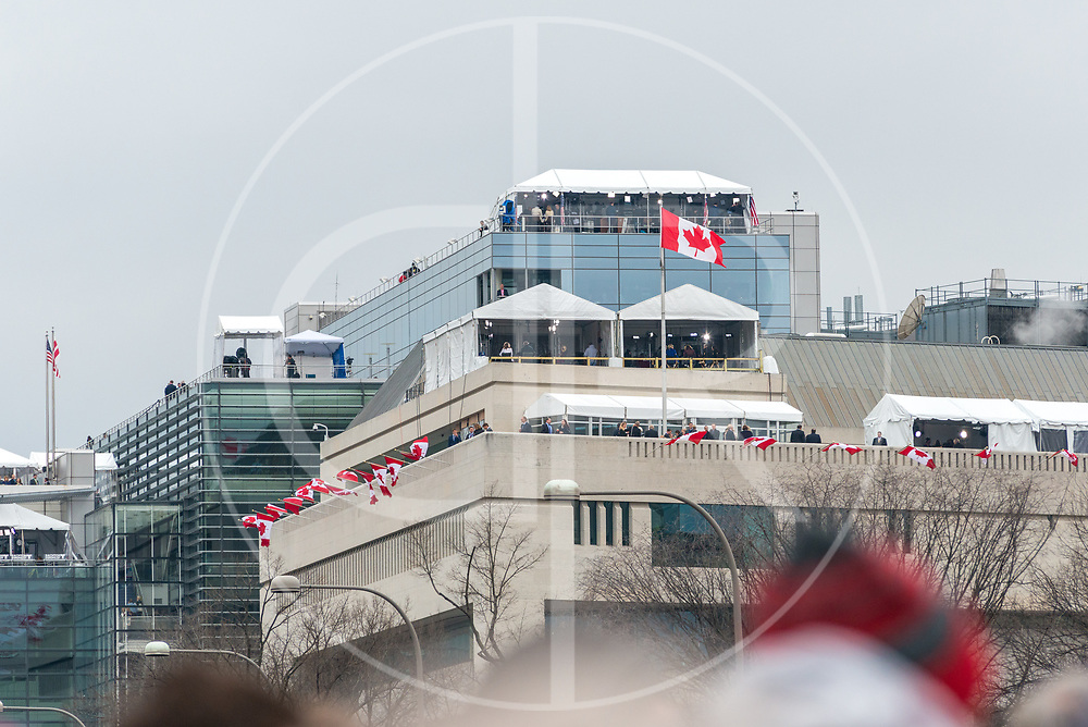Washington DC, United States - News outlets broadcasting Trump's 2017 inauguration can be seen atop the Canadian Embassy.