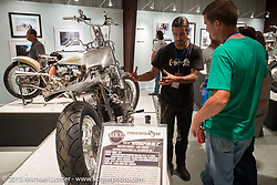 """Builder Lock Baker of Eastern Fabrications speaks about his raw custom bike built from an H-D twin cam at the industry party for the Motorcycles as Art show titled """"The Naked Truth"""" at the Buffalo Chip. SD, USA.  August 2, 2015.  Photography ©2015 Michael Lichter."""