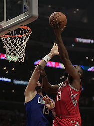 October 21, 2018 - Los Angeles, California, U.S - Marcin Gortat #13 of the Los Angeles Clippers tries to block James Harden #13 of the Houston Rockets as he drives to the basket during their NBA game on Sunday October 21, 2018 at the Staples Center in Los Angeles, California. (Credit Image: © Prensa Internacional via ZUMA Wire)
