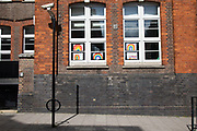 Children put up rainbow paintings in the window of their school in Covent Garden as lockdown continues and people observe the stay at home message in the capital on 11th May 2020 in London, England, United Kingdom. Coronavirus or Covid-19 is a new respiratory illness that has not previously been seen in humans. While much or Europe has been placed into lockdown, the UK government has now announced a slight relaxation of the stringent rules as part of their long term strategy, and in particular social distancing.