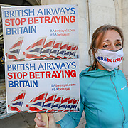 As British Airways planes are grounded due to the coronavirus outbreak the airliner announced plans that could see 12,000 jobs cut from its 42,000 strong workforce amidst a global collapse in air travel caused by the pandemic. Some of the company's employees took to the streets on Friday, May 29, 2020, to protest the company's decision calling it a betrayal. (Photo/ Vudi Xhymshiti)