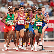 TOKYO, JAPAN August 3:   Lesiba Mashele of South Africa, Grant Fisher of the United States and Paul Chelimo of the United States in action during the Men's 5000m round one heat two race at the Olympic Stadium during the Tokyo 2020 Summer Olympic Games on August 3rd, 2021 in Tokyo, Japan. (Photo by Tim Clayton/Corbis via Getty Images)