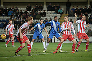 Charlie Lee (Stevenage) watches on as there is confusion in the Stevenage penalty box as the cross is headed back across the area during the Sky Bet League 2 match between Hartlepool United and Stevenage at Victoria Park, Hartlepool, England on 9 February 2016. Photo by Mark P Doherty.
