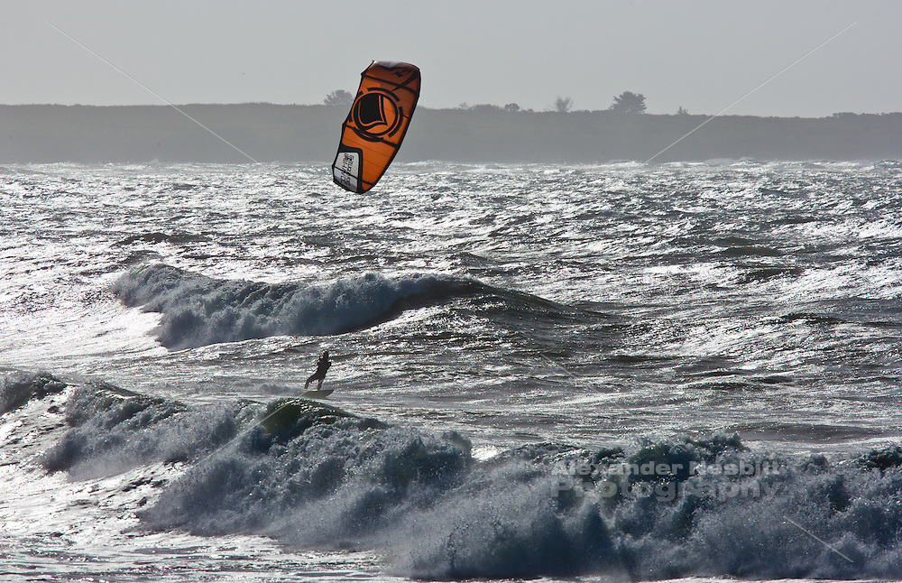 Sachuest Beach, Middletown, RI - Jeff Soderbergh gets a morning kiteboarding session on the calmer side of an early October gale