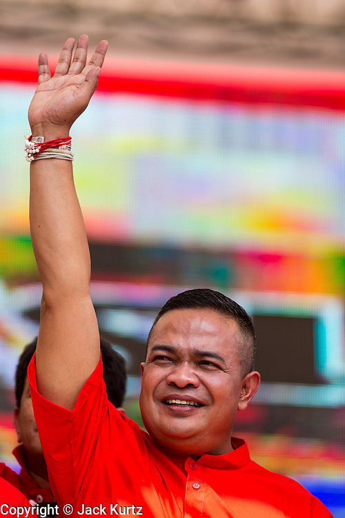 20 NOVEMBER 2013 - BANGKOK, THAILAND: JATUPORN PROMPAN, one of the core leaders of the Red Shirts and member of parliament in the Pheu Thai party, waves to Red Shirts at a rally in Bangkok. Thousands of Red Shirts, supporters of the Pheu Thai ruling party in Thailand, gathered in Rajamangala Stadium in suburban Bangkok to listen to the Thai Constitutional Court deliver its verdict against the government. The court ruled that the recent efforts by the government to pass a blanket amnesty bill violated the Thai Constitution but the court did not order the party to disband or the dissolution of the government, which had been widely feared.     PHOTO BY JACK KURTZ