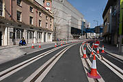 New tramlines on a very empty Broad Street, which is Birminghams main street for entertainment and bars, but with barely anyone walking around during the third national coronavirus lockdown on 30th March 2021 in Birmingham, United Kingdom.