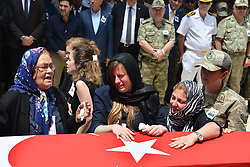 Relatives of Turkish soldier Serhat Signak who was killed in a helicopter crash in Sirnak, on 31 May 2017, mourn over his coffin during a funeral ceremony in Adana, Turkey, 01 June 2017. At least 13 soldiers were reported killed in the helicopter crash in Sirnak city. (Yusuf Bastug- Dha - Depo Photos)