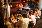 On Nan Chang Rd (Nanchang Lu) These Shanghainese men play cards and many others watch outside in the humid June heat. Shanghai is a city whose people live outside on the streets the whole year round in the areas where there is still traditional housing. In the summer they try to keep cool, then in the winter months, cards are still played, just with the participants in more clothing. Anything from a card game to an argument is reason for others to gather to spectate.