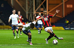 Chris Humphrey of Preston North End is tackled by Junior Stanislas of Bournemouth  - Mandatory byline: Matt McNulty/JMP - 07966386802 - 22/09/2015 - FOOTBALL - Deepdale Stadium -Preston,England - Preston North End v Bournemouth - Capital One Cup - Third Round