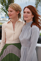 Actress Mia Wasikowska and Julianne Moore at the photo call for the film Maps To The Stars at the 67th Cannes Film Festival, Monday 19th May 2014, Cannes, France.