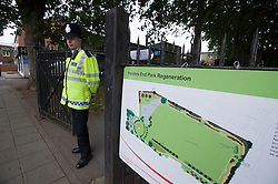 © Licensed to London News Pictures. 18/08/2011. Police guard the entrance to Ponders End Recreation Ground in Enfield, London today (18/08/2011) where a 14 Year-old boy was found stabbed to death yesterday afternoon. Photo credit: Ben Cawthra/LNP