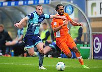 Blackpool's Nathan Delfouneso under pressure from Wycombe Wanderers' Michael Harriman<br /> <br /> Photographer Kevin Barnes/CameraSport<br /> <br /> The EFL Sky Bet League Two - Wycombe Wanderers v Blackpool - Saturday 11th March 2017 - Adams Park - Wycombe<br /> <br /> World Copyright © 2017 CameraSport. All rights reserved. 43 Linden Ave. Countesthorpe. Leicester. England. LE8 5PG - Tel: +44 (0) 116 277 4147 - admin@camerasport.com - www.camerasport.com