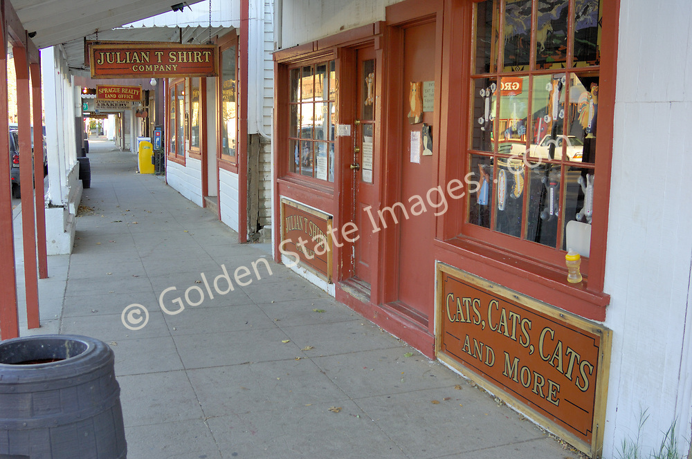 Shops Along Main Street in Downtown Julian. <br /> <br /> Julian was founded as a California gold rush town. In 1869 a cattleman Fred Coleman found a few flecks of gold in a small creek. <br /> <br /> Soon displaced confederate civil war veterans flocked to the area to seek their fortunes. <br /> <br /> One of them was Mike Julian after which the town is named. <br /> <br /> The gold rush was short lived but ranching farming and later apple orchards followed. <br /> <br /> Apples pies and cider became Julian's gold.