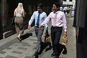 As heatwave temperatures climb to record levels - the hottest day of the year so far - Londoners in the City of London (the capital's financial district aka the Square Mile) walk in lunchtime sunshine, on 25th July 2019, in London, England.