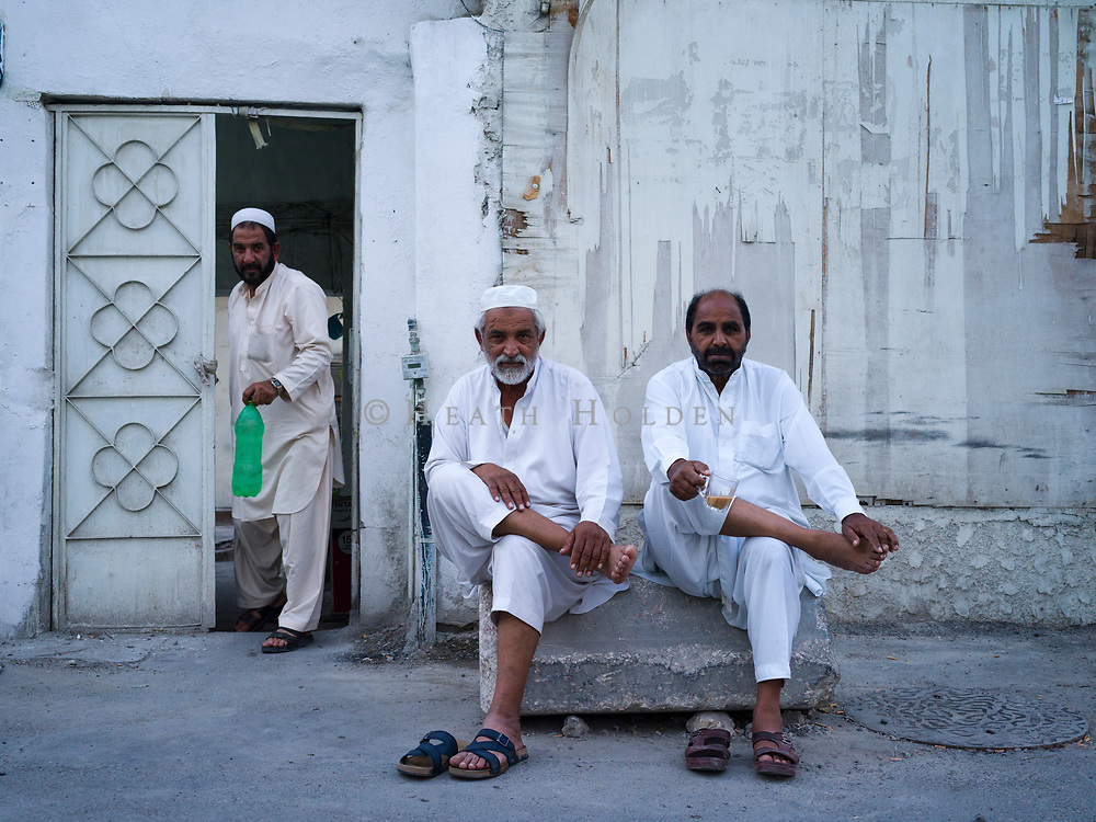 Kanan Khan and Noor Khan sit with a tea on a Thursday afternoon in one of Doha's older neighbourhoods. Atmospheric scenes of daily life from some of Doha's older neighbourhoods where the authentic Middle Eastern feel is still intact, for now.