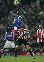 Photo: Lee Earle.<br /> Portsmouth v Sheffield United. The Barclays Premiership. 23/12/2006. Portsmouth's Sol Campbell (L) battles with Rob Hulse.