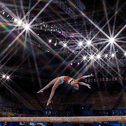 TOKYO, JAPAN - JULY 29: Nina Derwael of Belgium performs her routine on the balance beam during the All-Around Final for Women at Ariake Gymnastics Centre during the Tokyo 2020 Summer Olympic Games on July 29, 2021 in Tokyo, Japan. (Photo by Tim Clayton/Corbis via Getty Images)<br /> <br /> <br /> (Note to editors: A special effects starburst filter was used in the creation of this image)