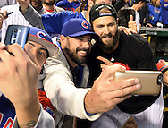CHICAGO, IL - OCTOBER 12:  Jake Arrieta #49 of the Chicago Cubs takes a selfie with a fan after Game 3 of the NLDS against the St. Louis Cardinals at Wrigley Field on Monday, October 12, 2015 in Chicago , Illinois. (Photo by Ron Vesely/MLB Photos via Getty Images) *** Local Caption *** Jake Arrieta
