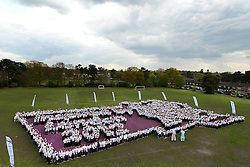 © Licensed to London News Pictures. 24/04/2012. Camberley, UK . A group of over 2,000 school children create the largest human London 2012 logo. The event covered 1,800 square meters at Collingwood College in Camberley. The event was organised by Surrey County Council to encourage youngsters to take part in sportPhoto credit : Stephen Simpson/LNP