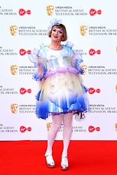Grayson Perry attending the Virgin Media BAFTA TV awards, held at the Royal Festival Hall in London. Photo credit should read: Doug Peters/EMPICS