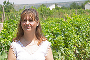 Olivera Juricic, the owner, in the vineyard. Vita@I Vitaai Vitai Gangas Winery, Citluk, near Mostar. Federation Bosne i Hercegovine. Bosnia Herzegovina, Europe.