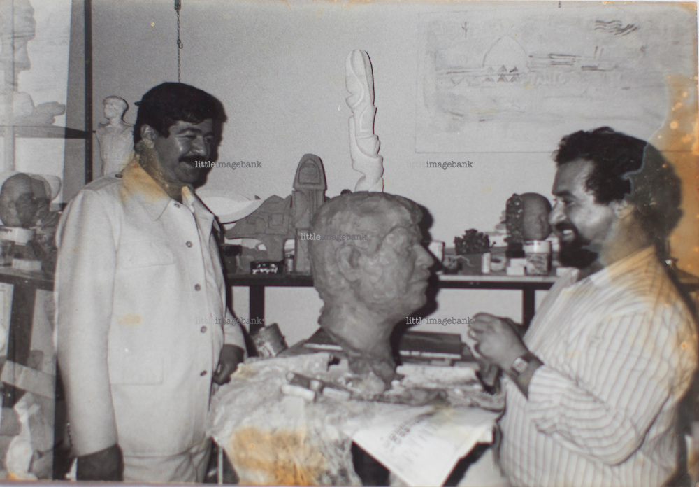 Fiumicino, Rome, 14.10.2010. Ali is seen in an undated photograph together with one of Saddam Husseins look alikes. Ali Al Jabiri is an Iraqi painter and sculpturer. Ali is the man behind the official portraits and sculptures of Saddam Hussein, that were destructed by US forces in the early stages of the invasion of Iraq. Today Ali lives outside Rome in the Fiumicino area. Photo: Christopher Olssøn.