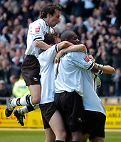Fotball<br /> England 2004/2005<br /> Foto: SBI/Digitalsport<br /> NORWAY ONLY<br /> <br /> Derby County v Preston North End<br /> Coca Cola Championship. 08/05/2005<br /> <br /> Derby's Paul Peschisolido (R) is mobbed by teammates after scoring his team's third goal in the 3-1 win, guaranteeing a play-off place.