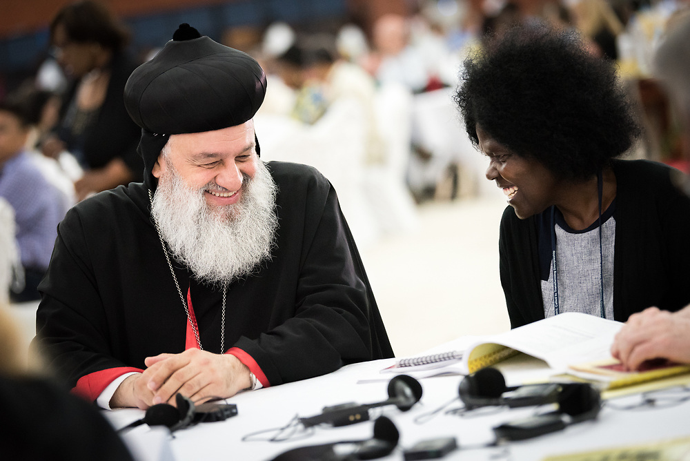"""12 March 2018, Arusha, Tanzania: HH Syrian Orthodox Patriarch Ignatius Aphrem II of Antioch (left) and dr Agnes Abuom (right) converse after morning prayers. From 8-13 March 2018, the World Council of Churches organizes the Conference on World Mission and Evangelism in Arusha, Tanzania. The conference is themed """"Moving in the Spirit: Called to Transforming Discipleship"""", and is part of a long tradition of similar conferences, organized every decade."""