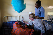 Dr. Kimberly Shriner examines an HIV patient at a hospital in Endulen, Tanzania. Dr. Shriner is the executive director of the Phil Simon Clinic, based in Pasadena, CA.