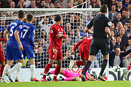 Chelsea midfielder Mateo Kovacic's(17) shot is blocked by Liverpool goalkeeper Alisson Becker (13) during the Premier League match between Chelsea and Liverpool at Stamford Bridge, London, England on 29 September 2018.