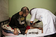 An injured Syrian patient received medical treament from a nurse, in a post-care centre for Syrians in the Turkish border town of Reyhanli. 04/01/2013
