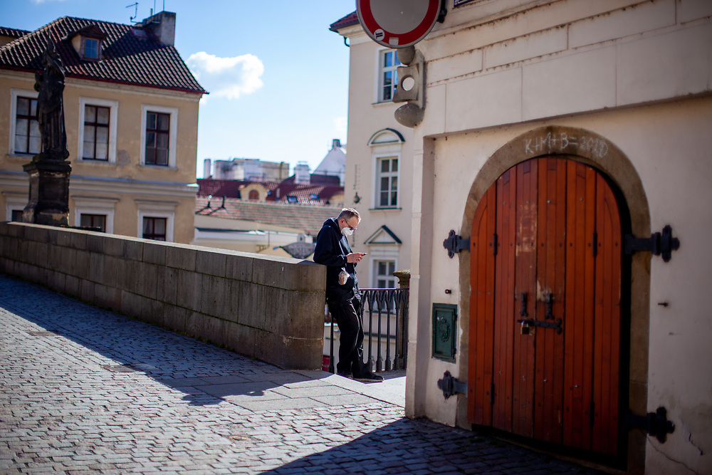 A man looking at his smart phone at Charles Bridge. On March 1st, 2021 the state of emergency in the Czech Republic was reinstalled because of fast increasing numbers in infections. The lockdown was reinstated and the restriction of the free movement of people has taken effect. Currently, the country remains at the highest stage of the anti-epidemiological system and the newly imposed restriction will last at least three weeks to curb the epidemic.