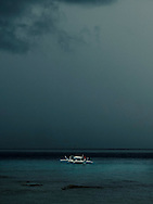 Bangka boat offshore of Anilao during a stormy day, Batangas, Calabarzon, Luzon Island, Philippines
