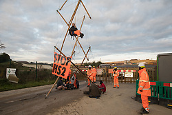 Anti-HS2 activists use a tripod to block one of several entrances to the Chiltern Tunnel South Portal site for the HS2 high-speed rail link for the entire day on 9 October 2020 in West Hyde, United Kingdom. The protest action, at the site from which HS2 Ltd intends to drill a 10-mile tunnel through the Chilterns, was intended to remind Prime Minister Boris Johnson that he committed to remove deforestation from supply chains and to provide legal protection for 30% of UK land for biodiversity by 2030 at the first UN Summit on Biodiversity on 30th September.