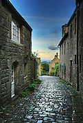 Beautiful old street of the village of Locronan, located in Finistere, Brittany, France after the morning showers