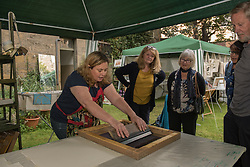 Portobello, Edinburgh's seaside suburb, is awash with Art. Almost everywhere you look there is something to see as the Art Walk Porty community art festival takes place, now extended to run over ten days covering the first two weekends of September. Pictured: Artist Claire MacDonald is giving fabric printing demonstrations at the weekend.<br /> <br /> <br /> © Jon Davey/ EEm