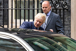 Boris Johnson accompanied by his senior advisor Dominic Cummings leaves Downing Street to deliver a statement to the House of Commons following the resumption of sitting after the Supreme Court ruled the proroguing of Parliament unlawful. London, September 25 2019.