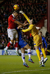Stuart Nelson of Gillingham punches clear as Derrick Williams of Bristol City tries a header - Photo mandatory by-line: Rogan Thomson/JMP - 07966 386802 - 29/01/2015 - SPORT - FOOTBALL - Bristol, England - Ashton Gate Stadium - Bristol City v Gillingham - Johnstone's Paint Trophy Southern Area Final Second Leg.