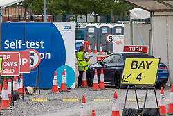 © Licensed to London News Pictures. 09/09/2020. London, UK. Members of the public arrive at a quiet Covid 19 Test Centre in Twickenham in South West London as Labour Leader Keir Starmer blasted Prime Minister Boris Johnson during PMQs over the handling of the UK's testing program and pointed out that many people weren't able to get a test near their homes and were being told to travel miles to get one. Earlier Health Minister Matt Hancock announced that from Monday a gathering of more than six people will be illegal in England and enforced with a £100 fine after a surge of cases. Photo credit: Alex Lentati/LNP