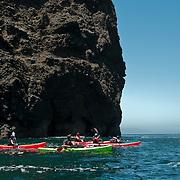 Volcanic sea caves honeycomb the shoreline of Santa Cruz Island, Channel Islands National Park, CA.