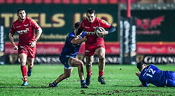 Scarlets' Paul Asquith evades the tackle of Leinster's Adam Coyle<br /> <br /> Photographer Craig Thomas/Replay Images<br /> <br /> Guinness PRO14 Round 17 - Scarlets v Leinster - Friday 9th March 2018 - Parc Y Scarlets - Llanelli<br /> <br /> World Copyright © Replay Images . All rights reserved. info@replayimages.co.uk - http://replayimages.co.uk