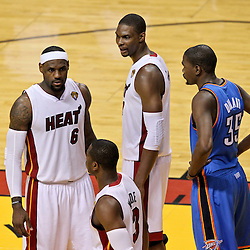 Jun 21, 2012; Miami, FL, USA; Miami Heat small forward LeBron James (6), power forward Chris Bosh (1), shooting guard Dwyane Wade (3) and Oklahoma City Thunder small forward Kevin Durant (35) on the court during the third quarter in game five in the 2012 NBA Finals at the American Airlines Arena. Mandatory Credit: Derick E. Hingle-US PRESSWIRE