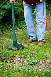 Using an electric rotary line trimmer (strimmer) on rough long grass