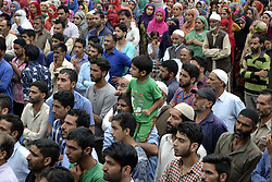 August 2, 2017 - India - Thousands of people attend the funeral prayers of Akeel Ahmed Bhat, a teenage boy during his funeral procession in Haal village, south of Srinagar, Akeel sustained serious injuries when government force fired pellet and bullets on protester during clashes in hall village ,he later succumbed to  injuries at local hospital in Indian controlled Kashmir, Wednesday, Aug. 2, 2017. (Credit Image: © Umer Asif/Pacific Press via ZUMA Wire)